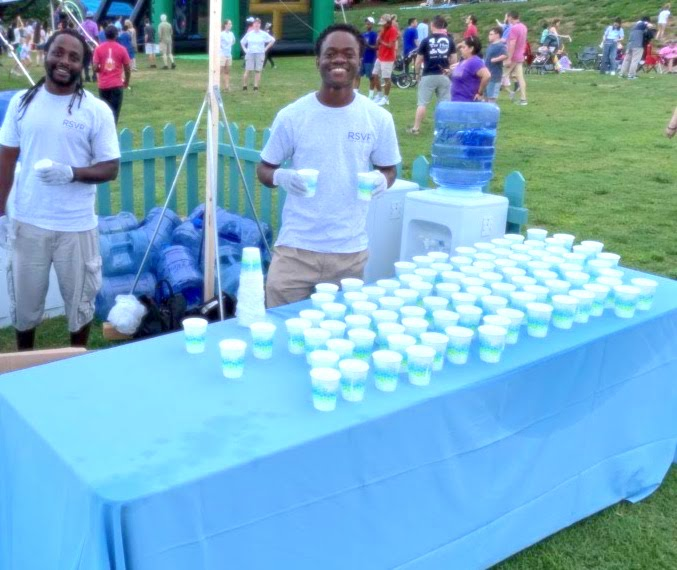 Sweepers at a table with cups of water