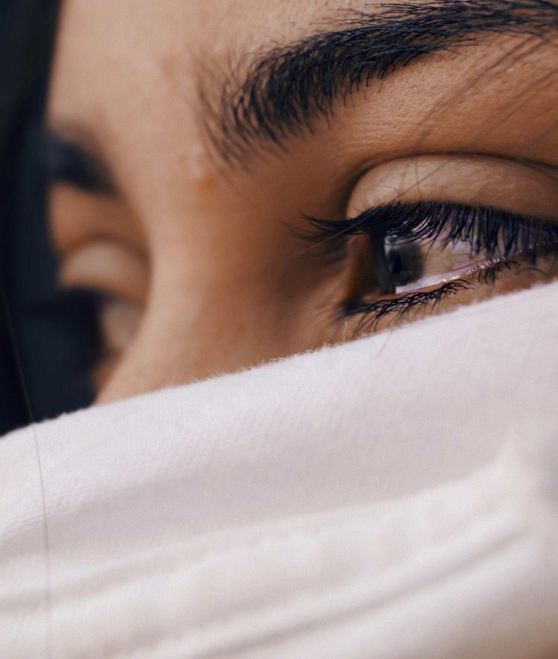 woman with tear in her eye