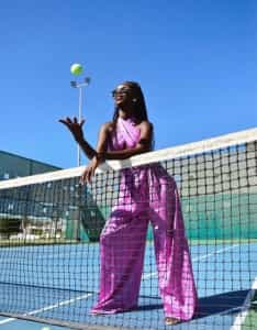 Fashionable woman on a tennis court