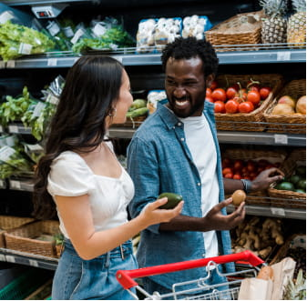 Couple shopping at a grocery store in the produce section