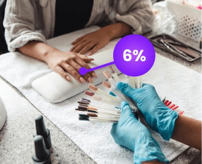Woman at nail salon selecting nail polish with cashback offer