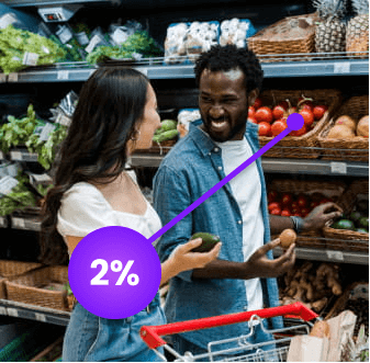 Couple shopping at a grocery store while getting cashback in produce section