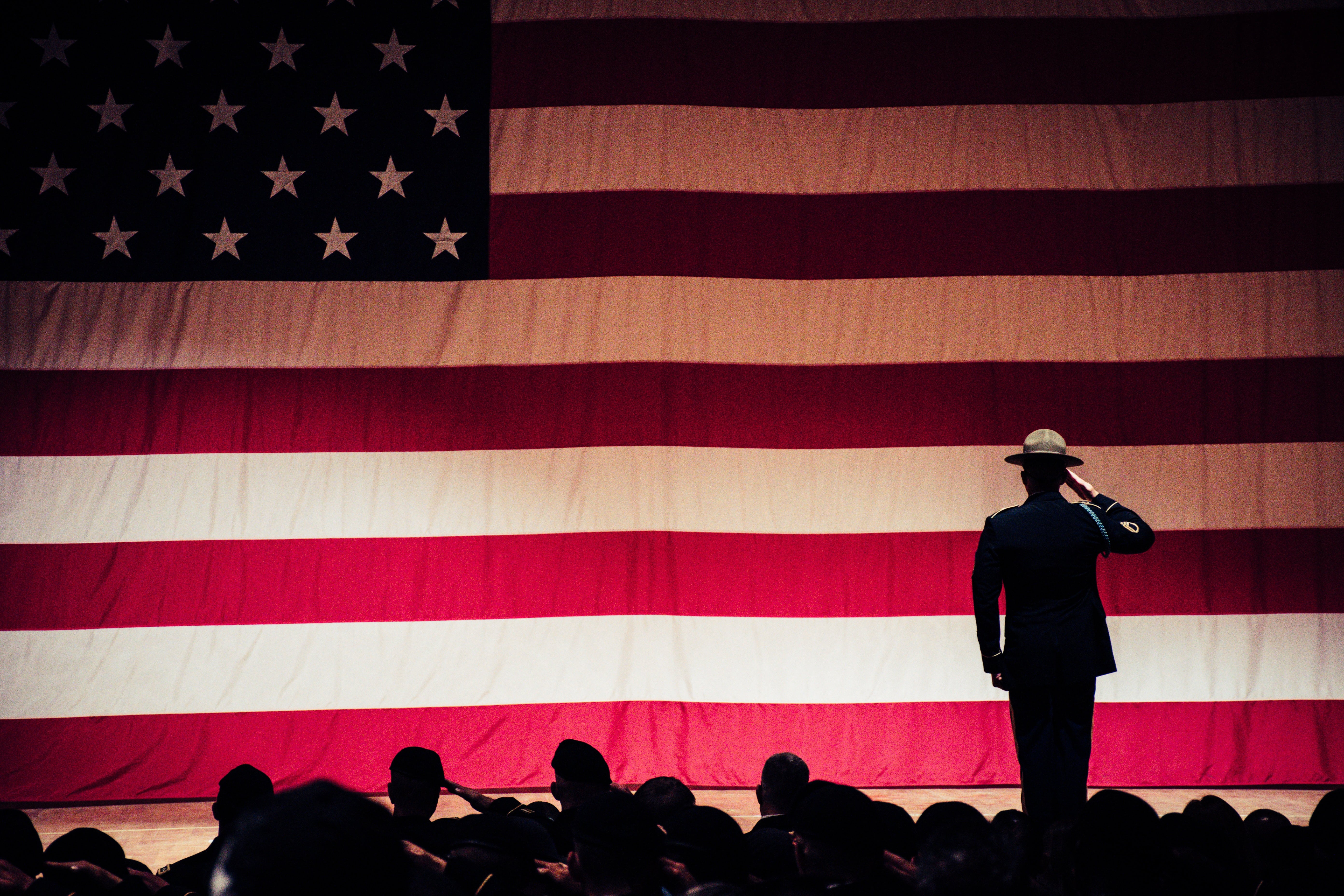 military officer saluting American flag