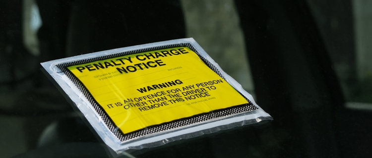 What happens if you get a fine or ticket in a rental car?
