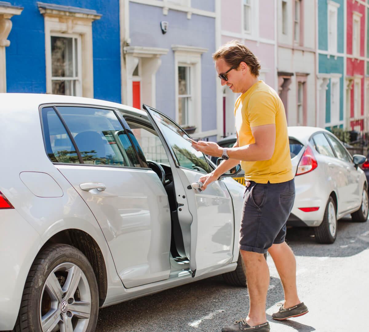 Car door of a car rental on car sharing app Karshare