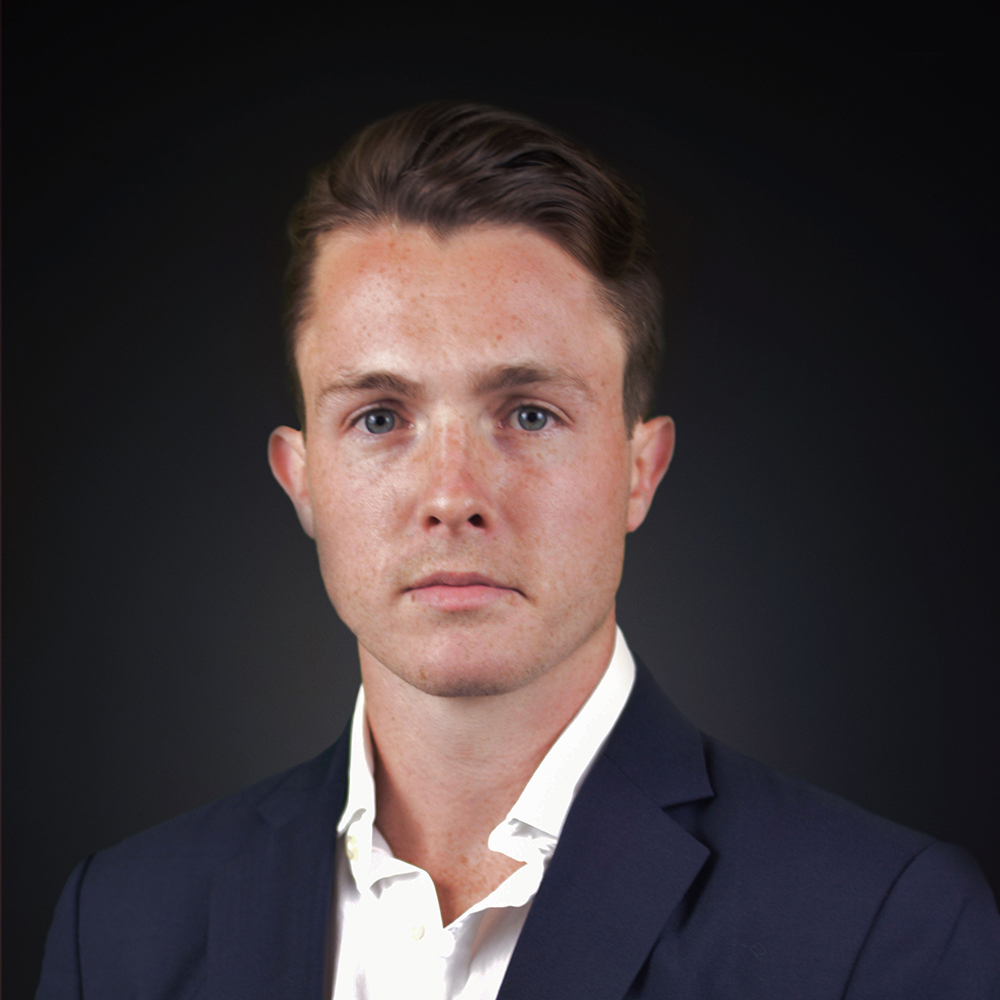 Photo of Lochie Burke. White male in his 20's with short hair. Black background
