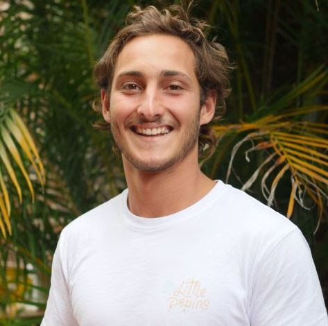 Photo of Afonso Firmo. Portuguese Male in his 20's with short hair. Plant background