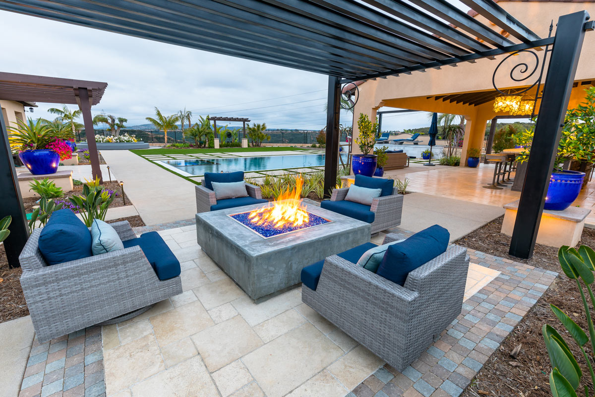 A custom pool with a fire pit and bar