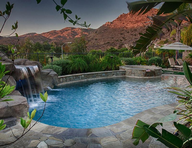 A custom pool with a waterfall