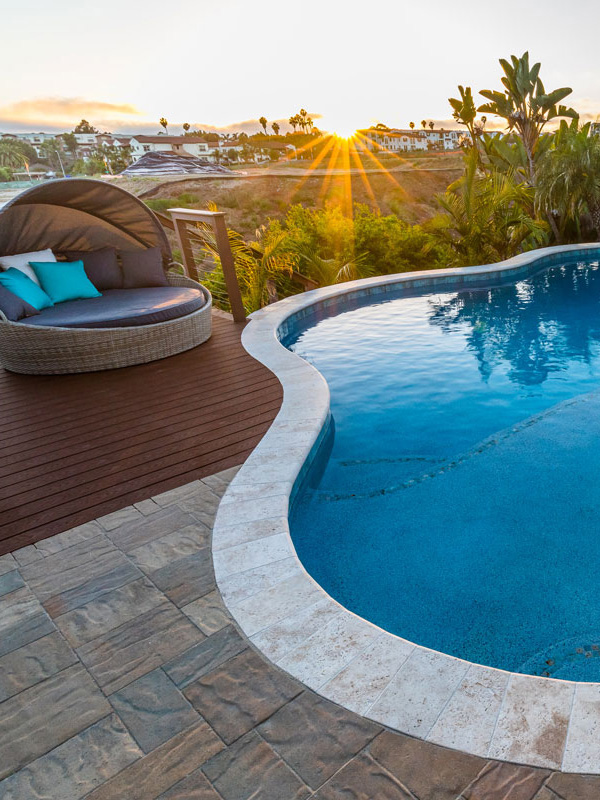A custom pool with a sunset and view