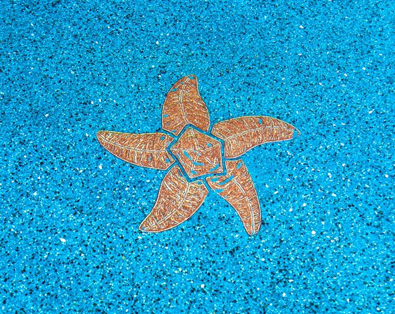 Custom designed tiled starfish under water.