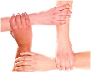 Hands together denoting cohesion.