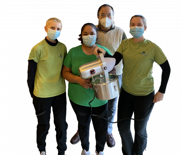 Our team holding disinfection equipment.