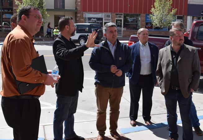 Brad Rowland describing main street projects to governor Cory Gardner
