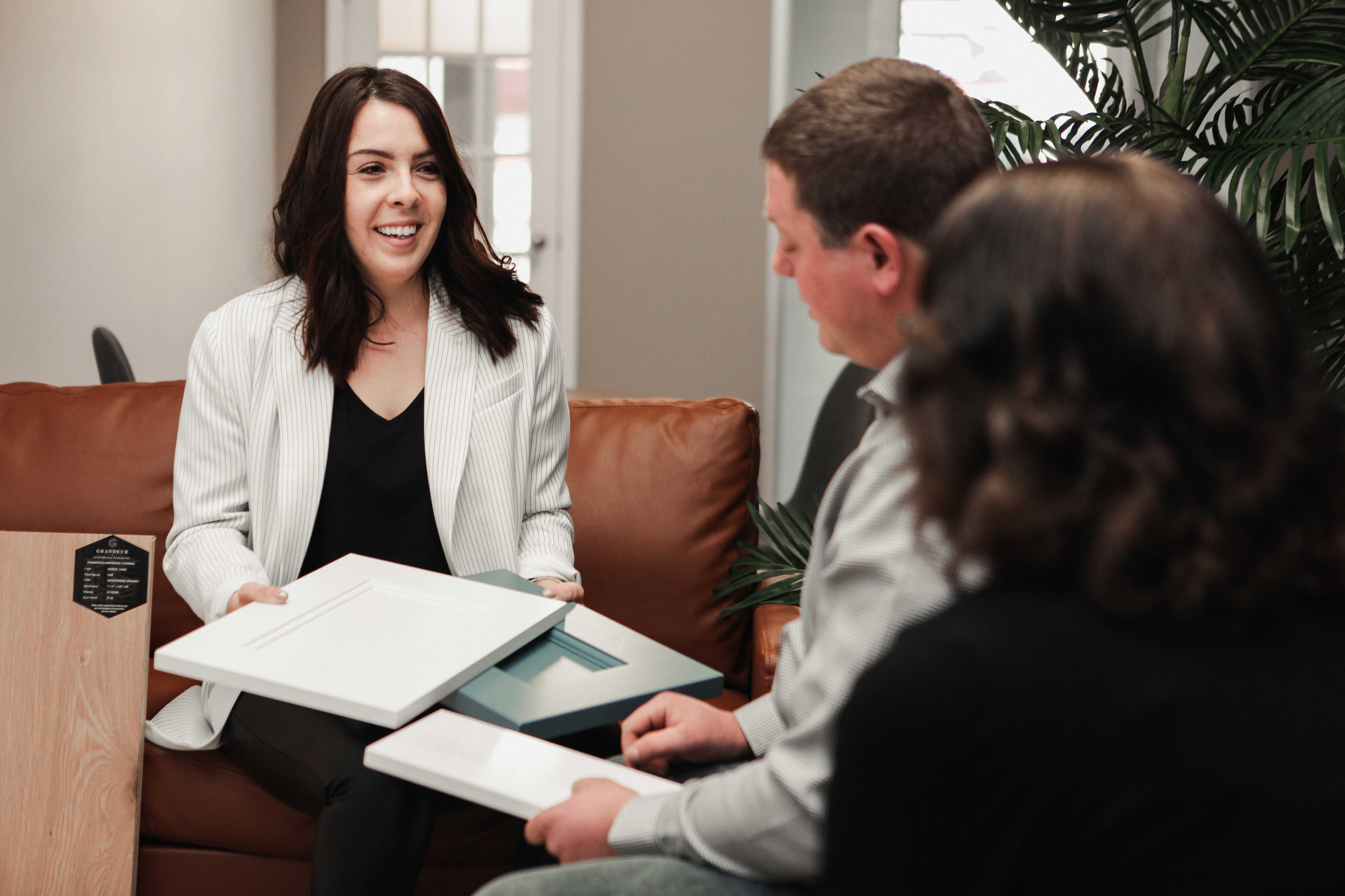 Taneigha, Interior Designer at Menard & Robertson, guiding clients through some samples