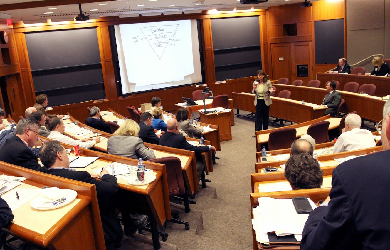 Diane speaking at a business school to an audience.