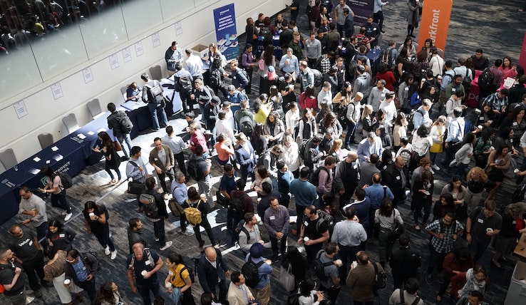 Image of a crowd of people at a conference.
