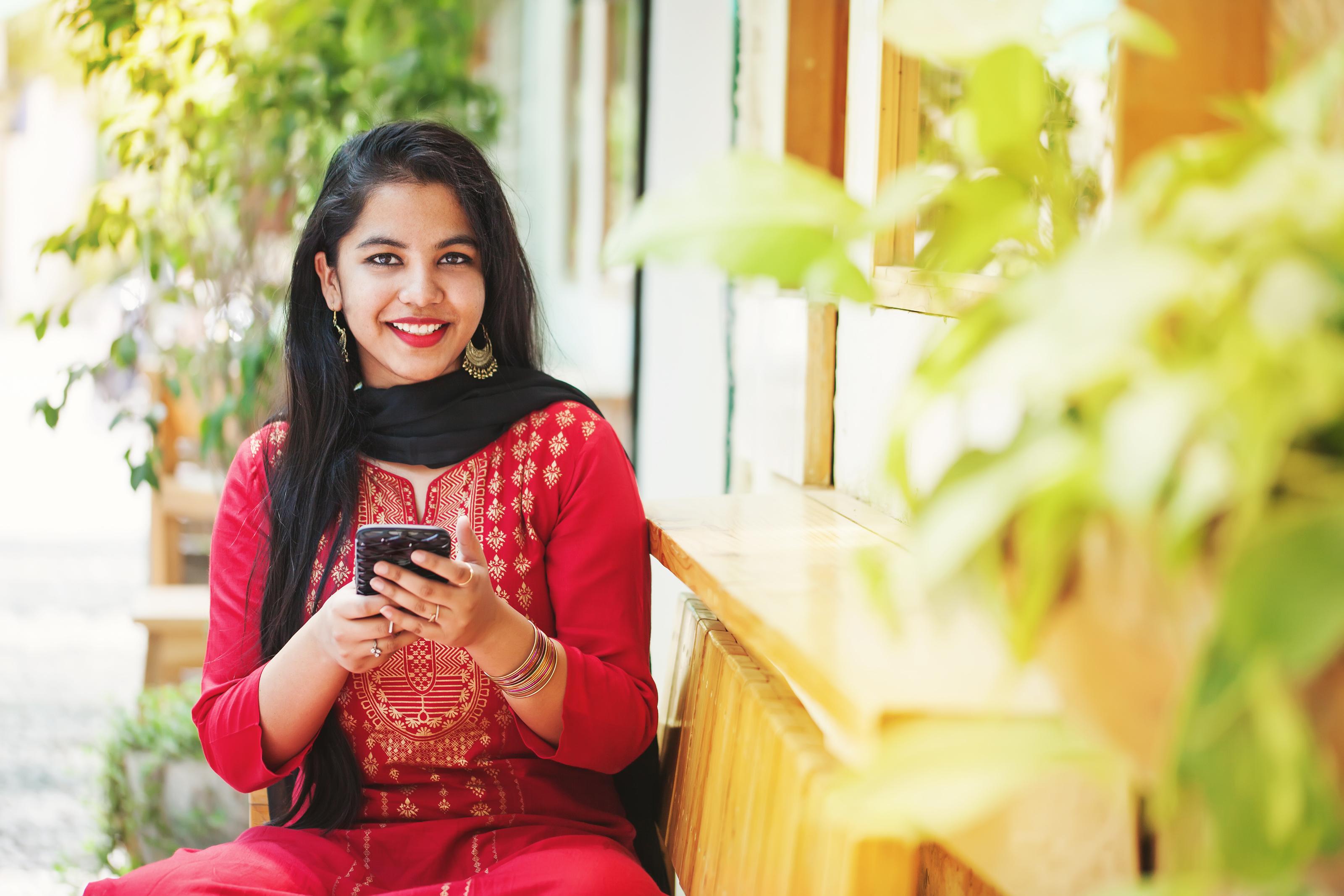 Indian girl using mobile banking