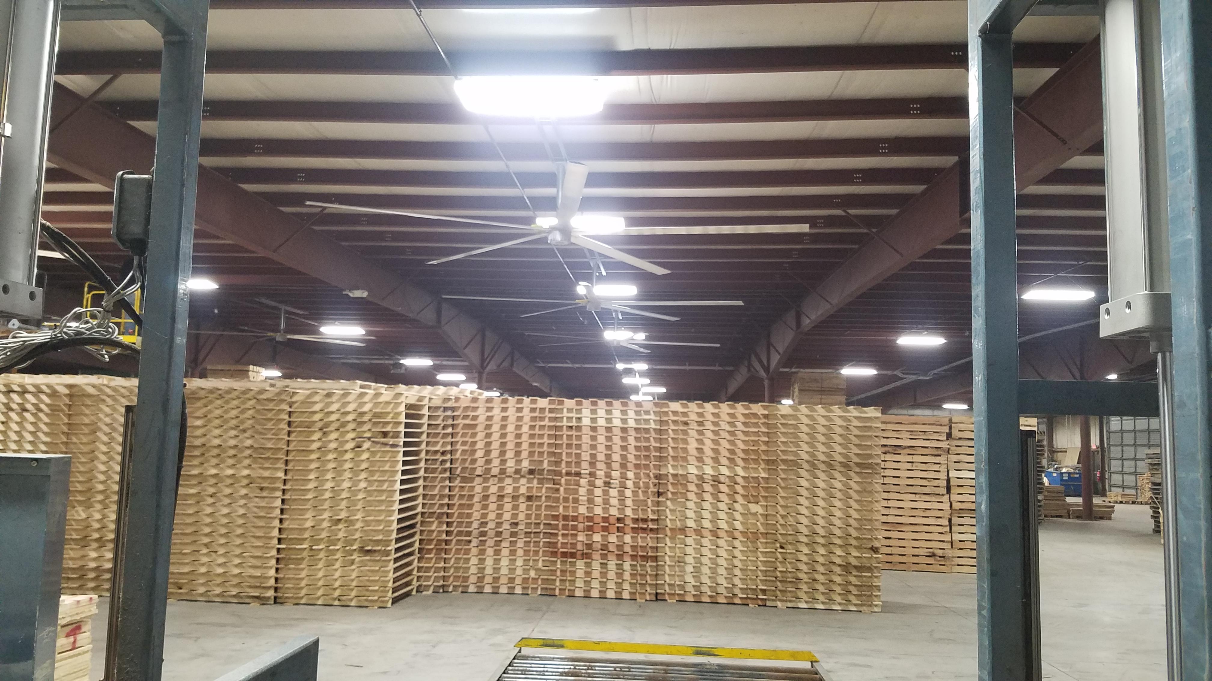 A ceiling fan in a pallet warehouse