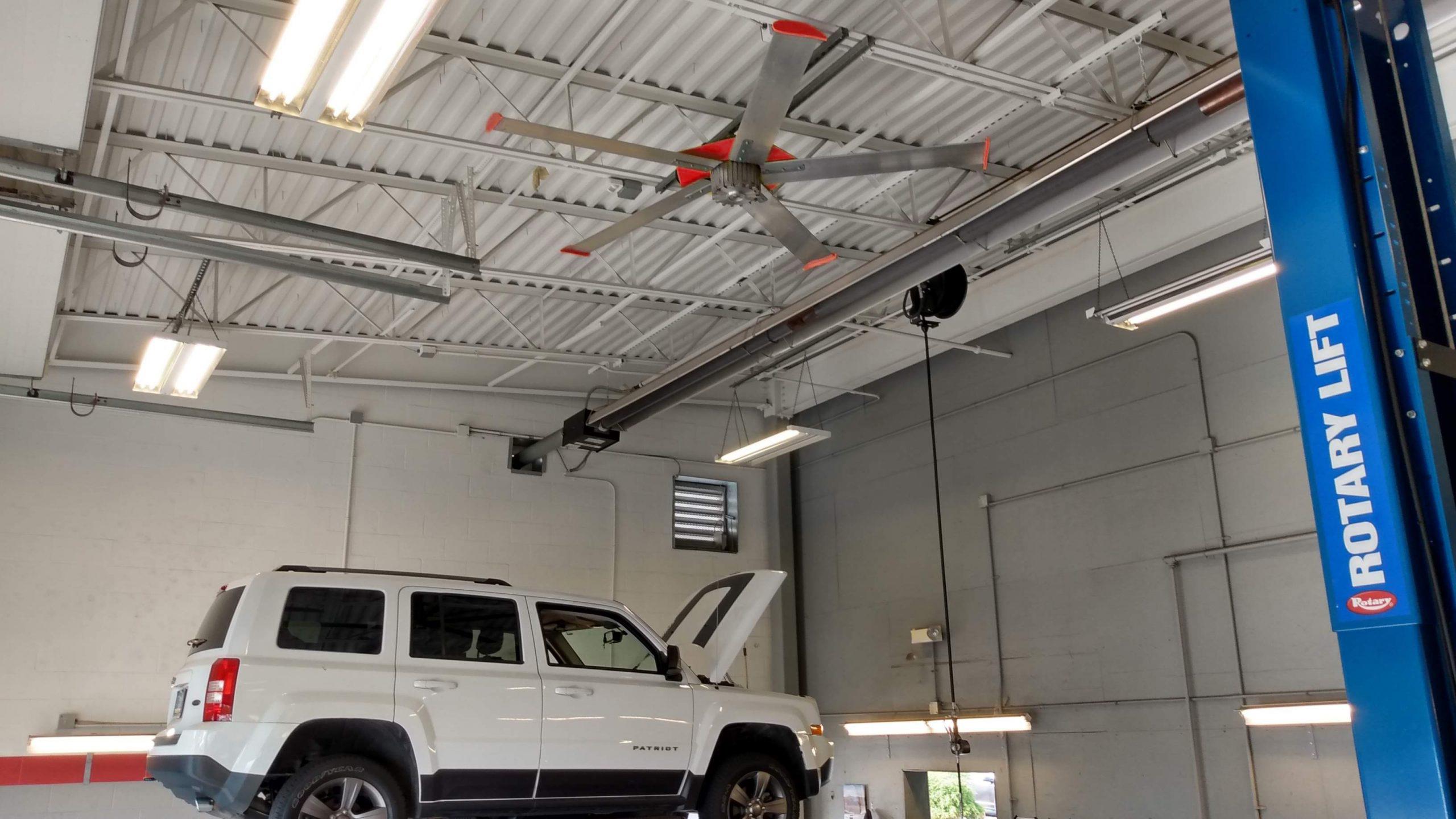 A big ceiling fan above a car lift