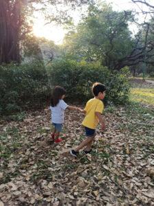 children running around in a park