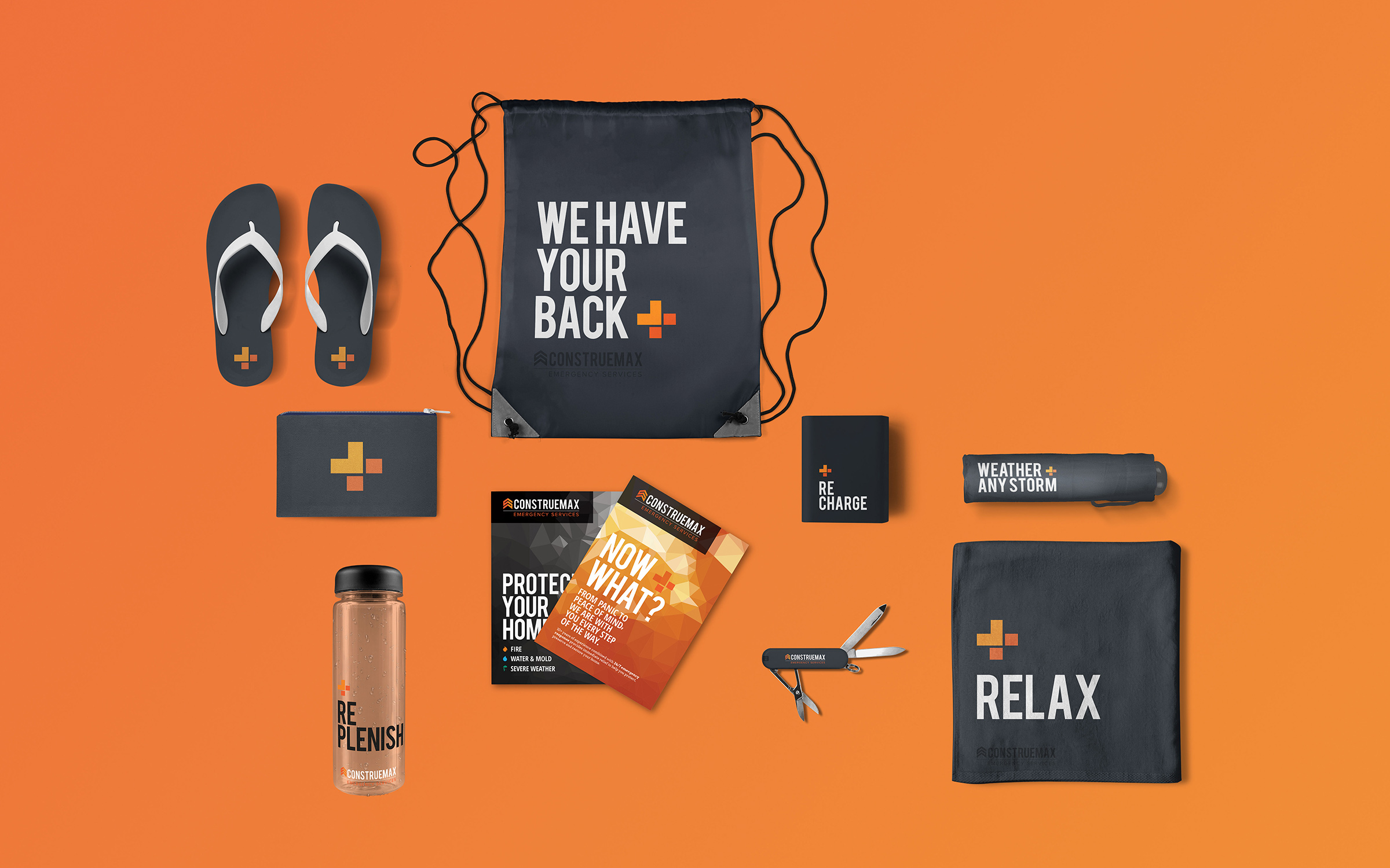 Various branded collateral items - flipflops, drawstring bag, umbrella, reusable water bottle, battery pack and multi-use tool on orange gradient