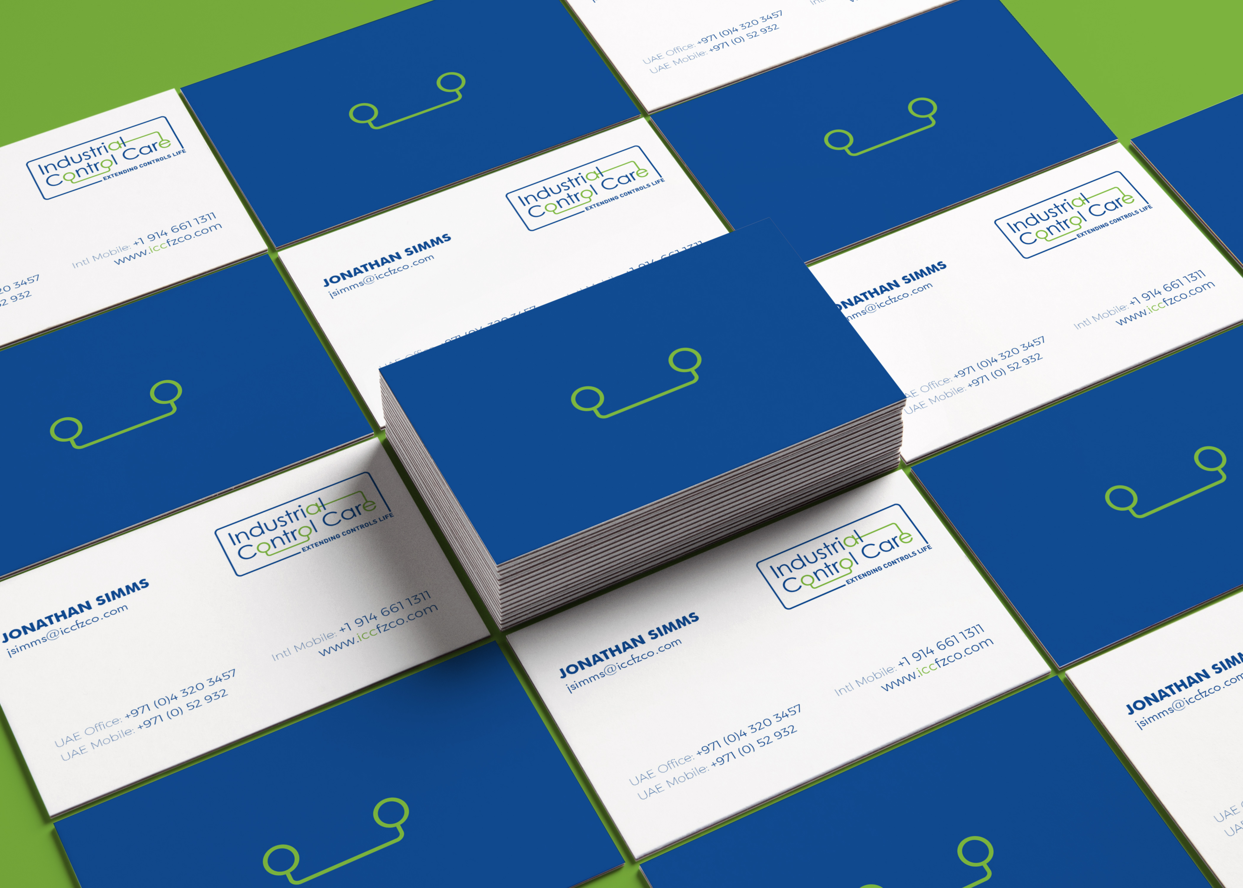 Blue and white business cards on a green background