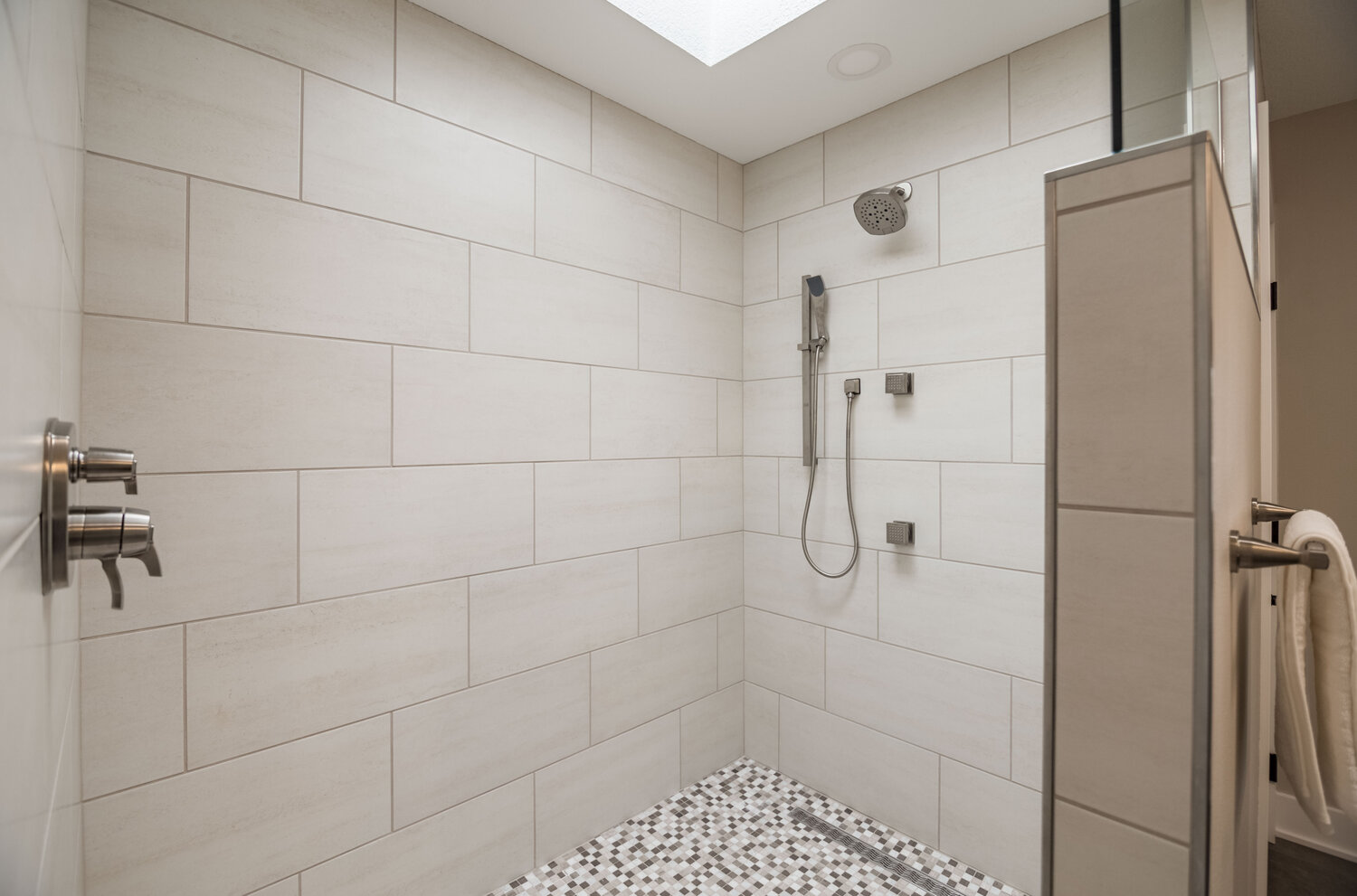 Shower Controls shown outside of spray zone, near entrance.