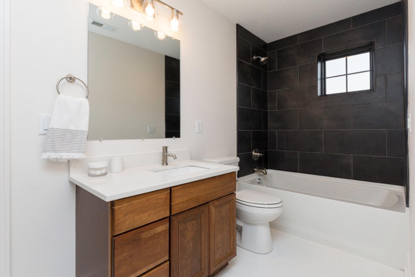 The Eleanor Custom Home - bath, toilet and sick.