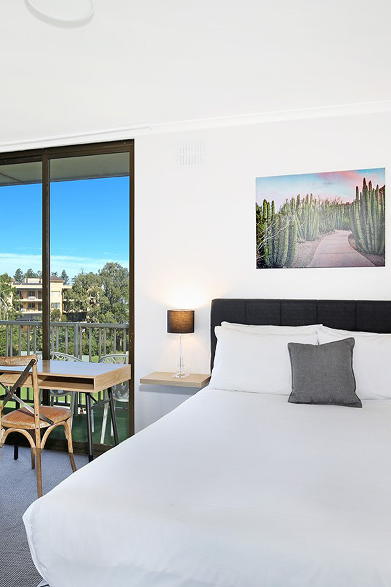 Large comfortable air-conditioned room with private balcony over-looking Wollongong Harbour & Osborne Park.