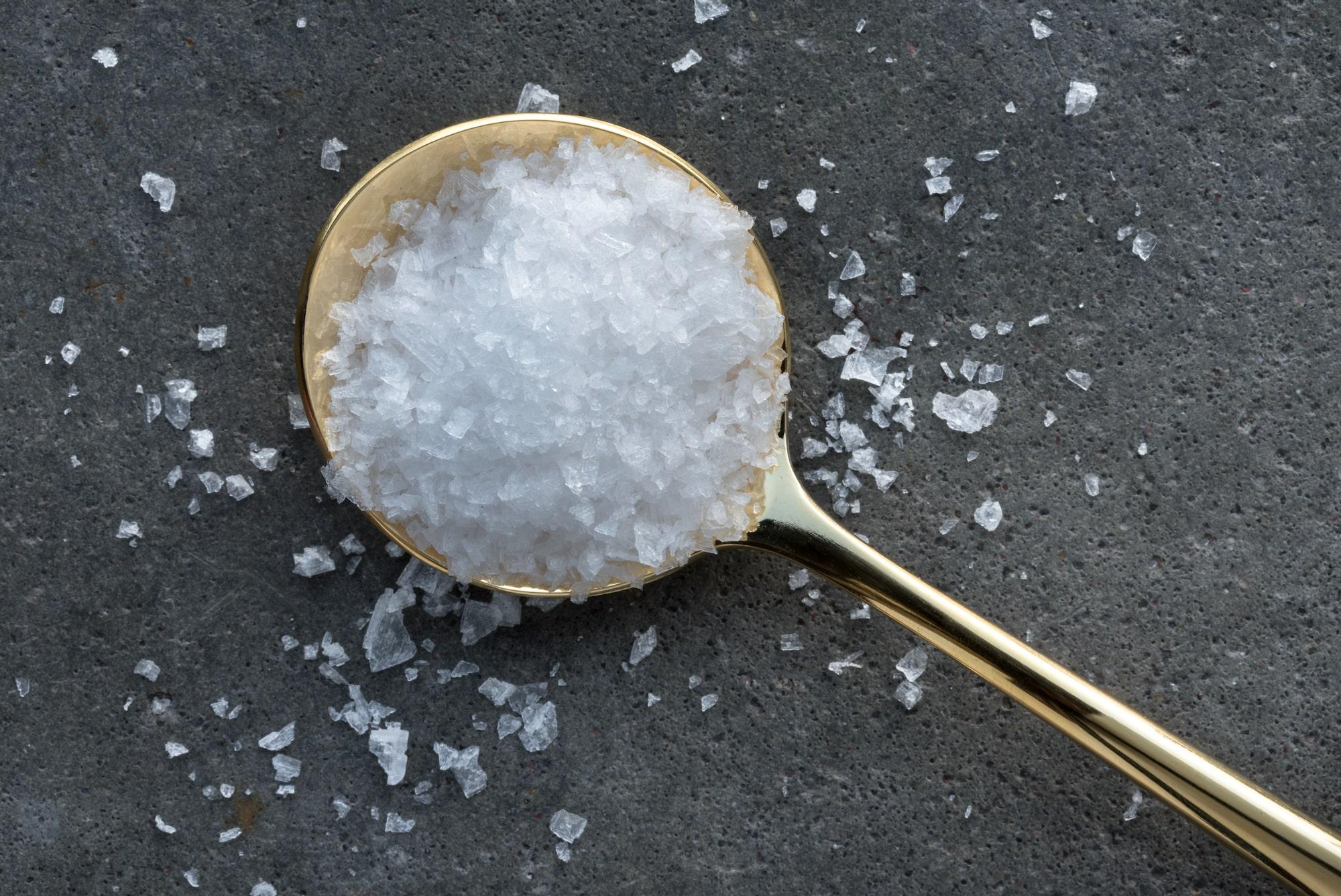 Sea salt flakes on a spoon