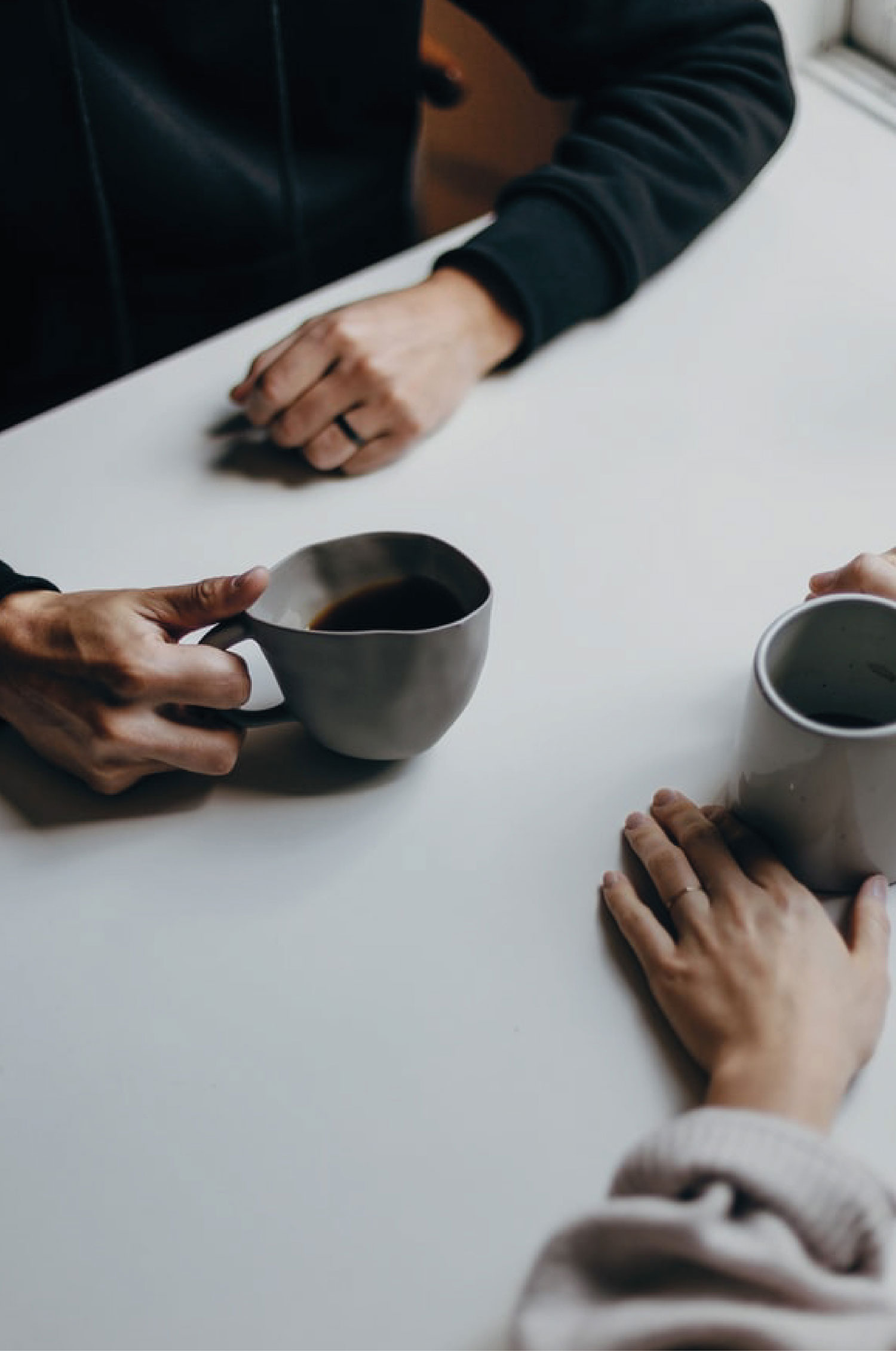 Two people having coffee together