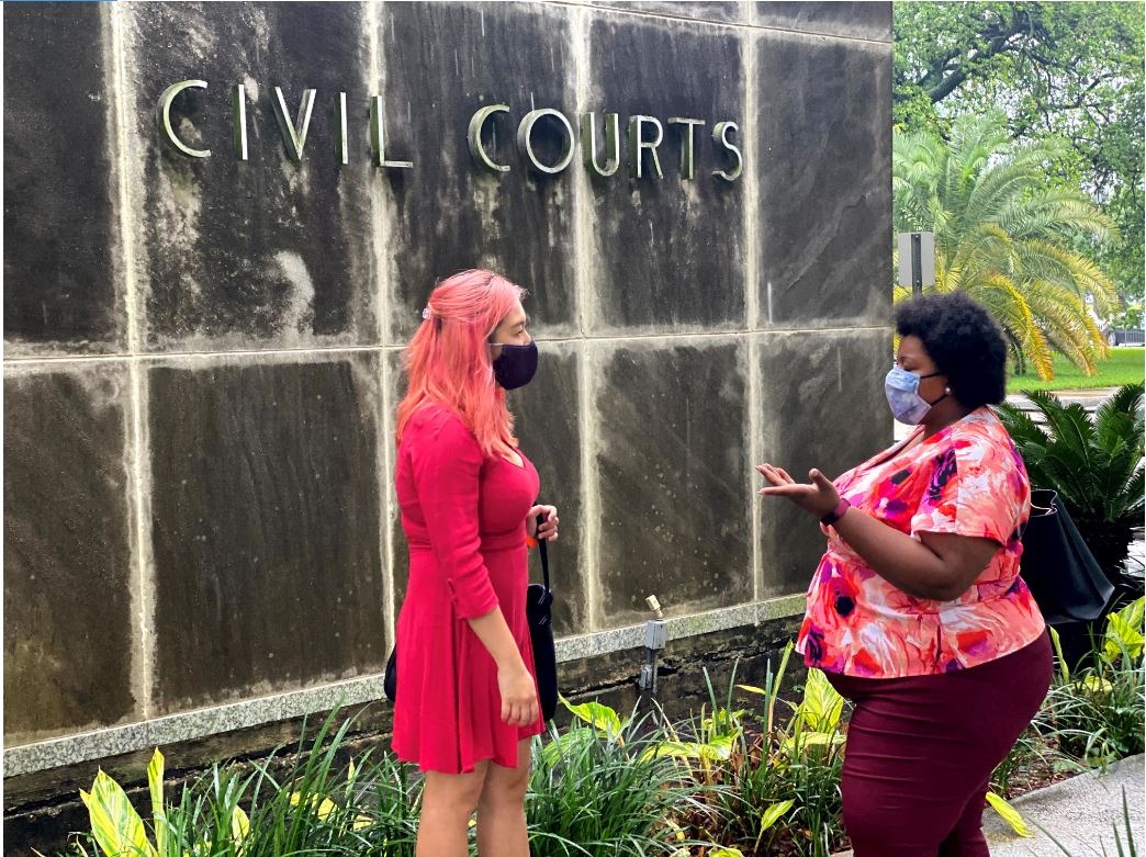 Wan Qi Kong and Ashley Payne talking about a case in front of the Orleans Parish civil court