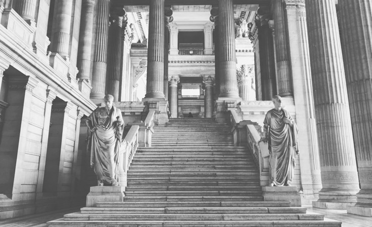 Courtroom stairs surrounded with elaborate architecture in black and white