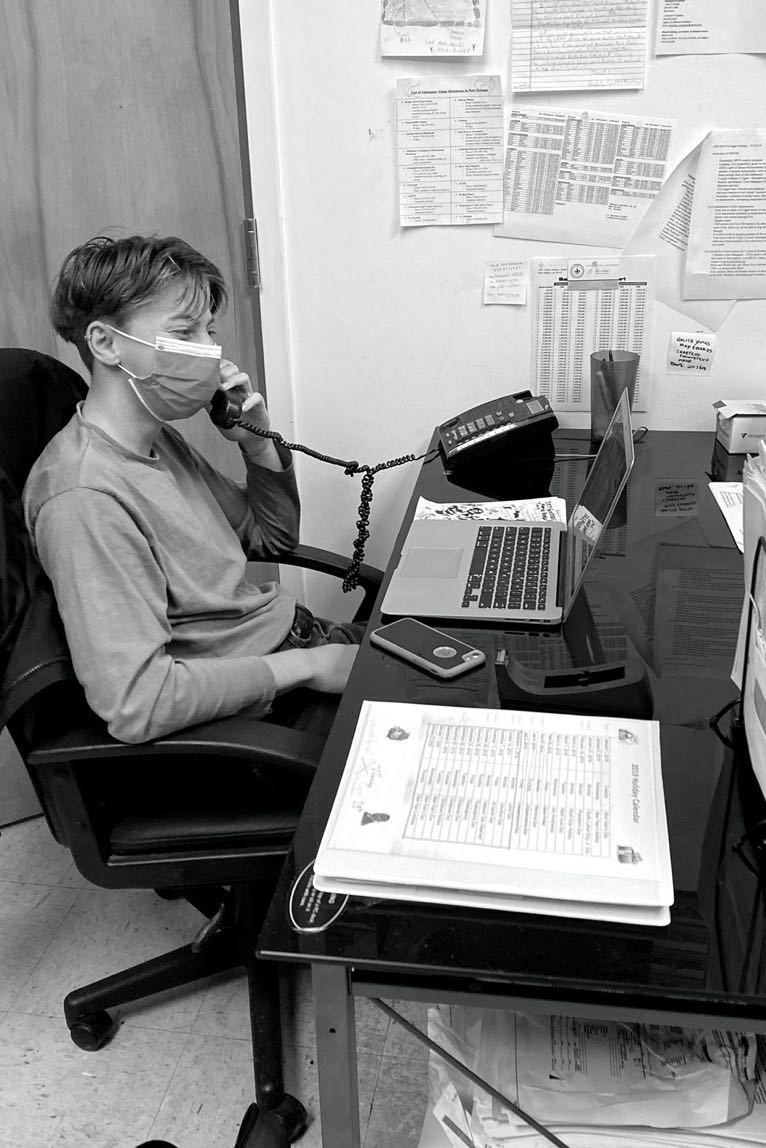 Advocate sitting at desk on the phone in black and white