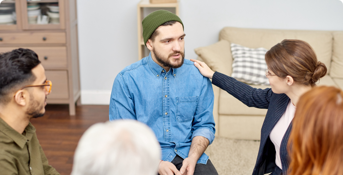 a support group comforting a man