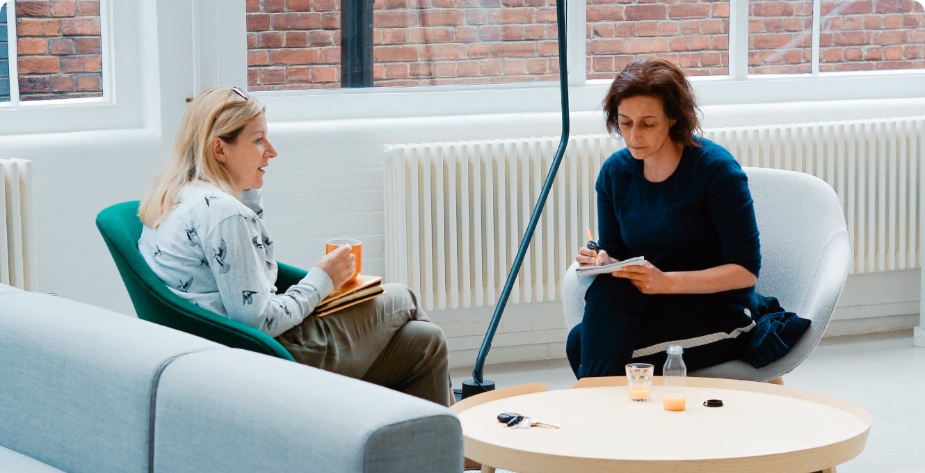 two women having a meeting discussing research