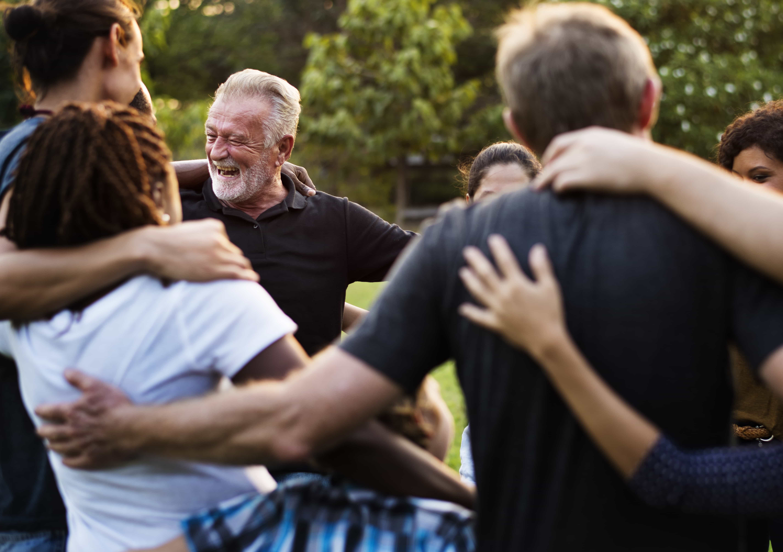 a group of Betknowmore UK volunteers hugging