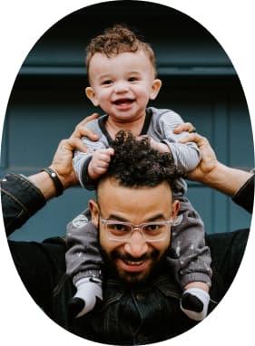 Child on parent's shoulders.