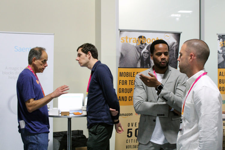 Tim and Russell talk to potential customers at The Next Web conference.