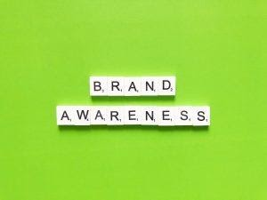 Brand awareness spelled with scrabble letters.