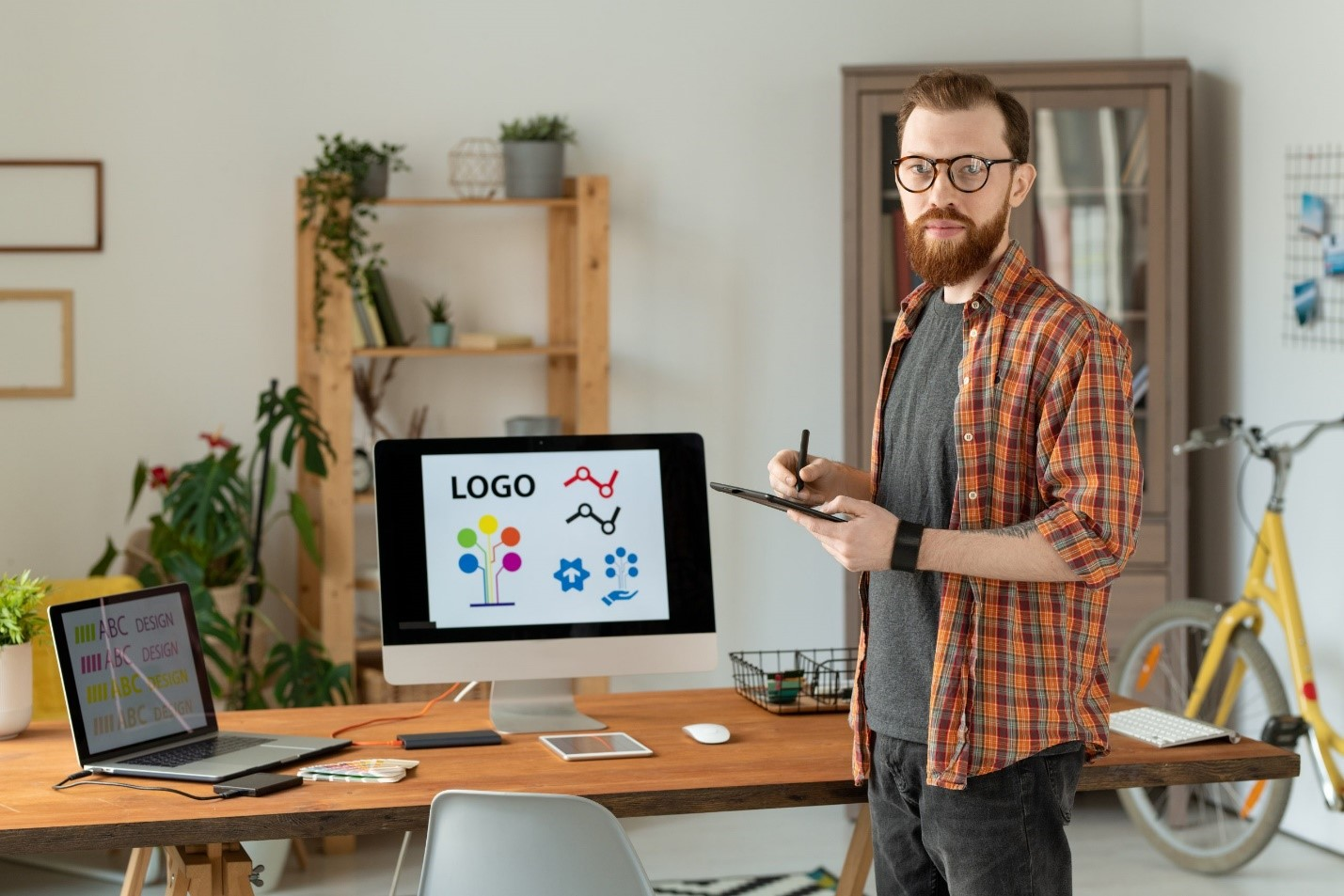 A designer working on branding in order to incorporate recommerce solutions.
