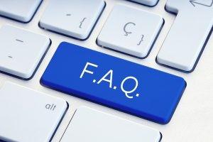 F.A.Q written on a blue key.