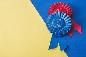Ribbons for first and second place, showing achievements as one of the methods of gamification in apps.
