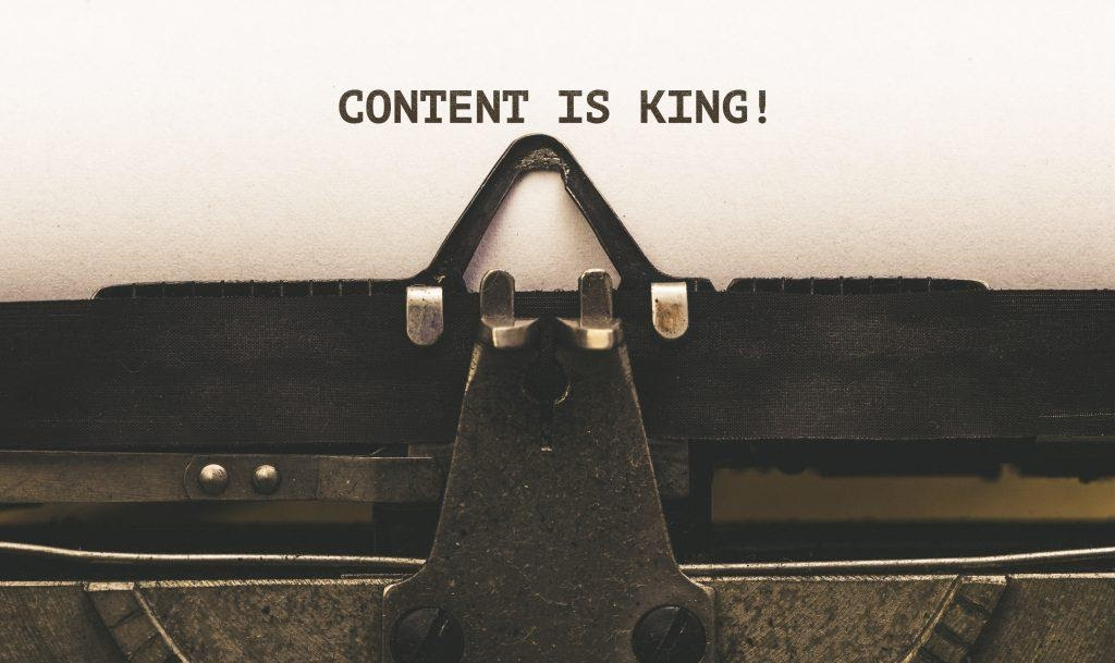 Content is king written in a typewritter, showing an important aspect to keep in mind when comparing brand storytelling vs content marketing.