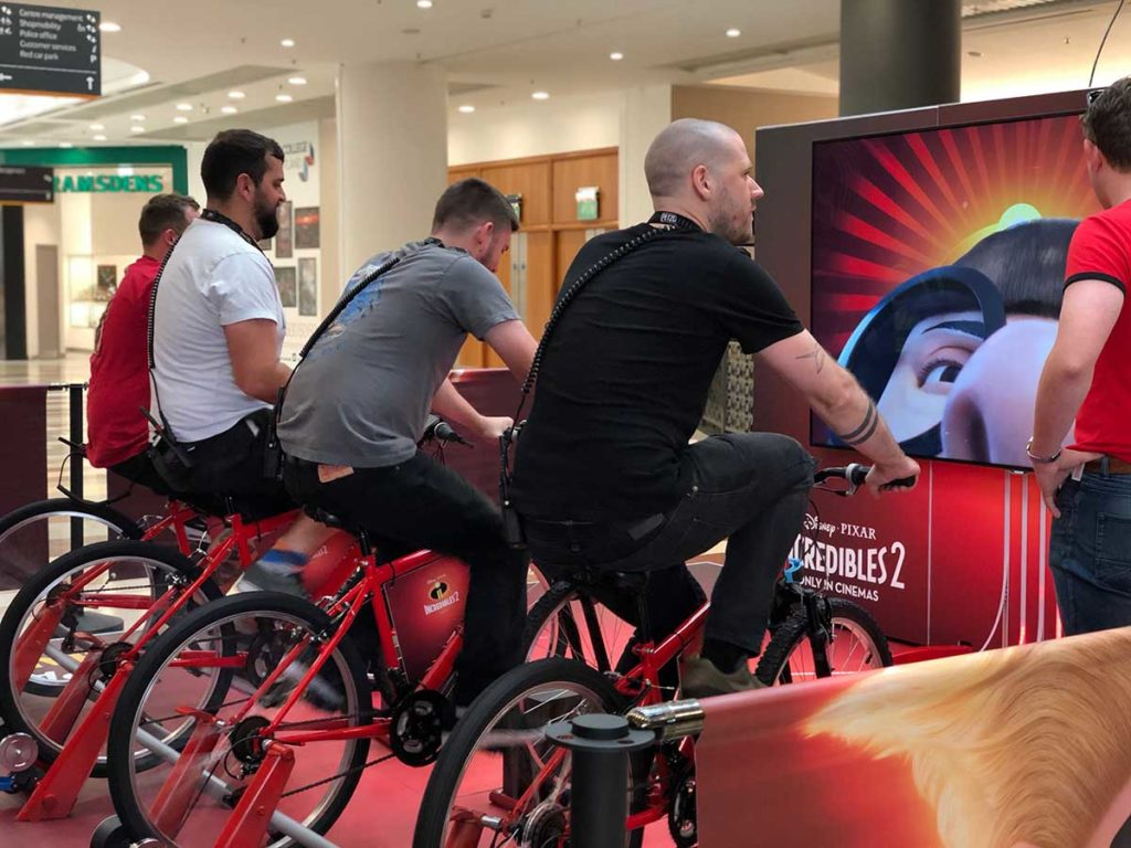 Immersive interactive experience using VR to enhance customer experience at showings of the Incredibles 2.