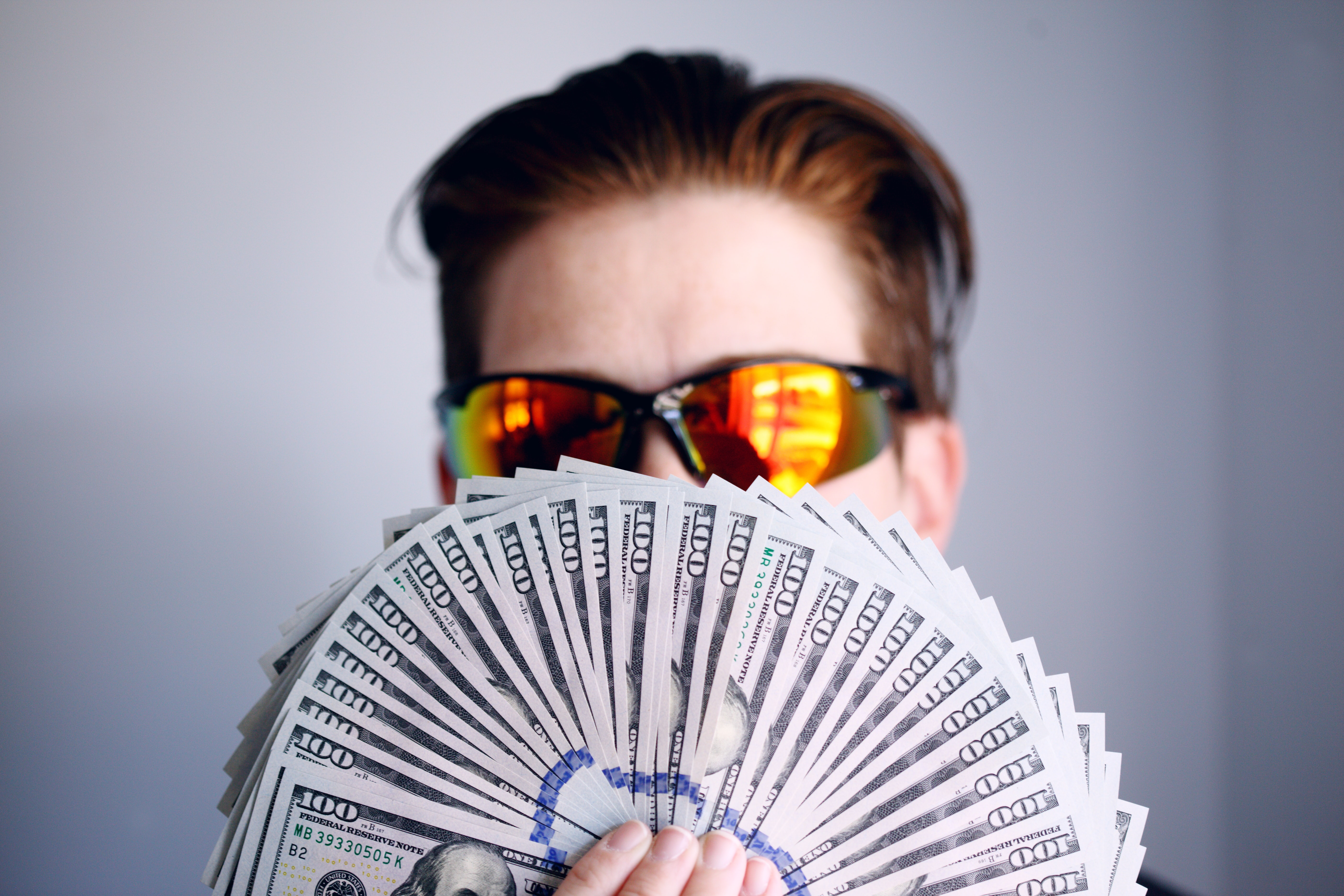 Man holding money in his hands.