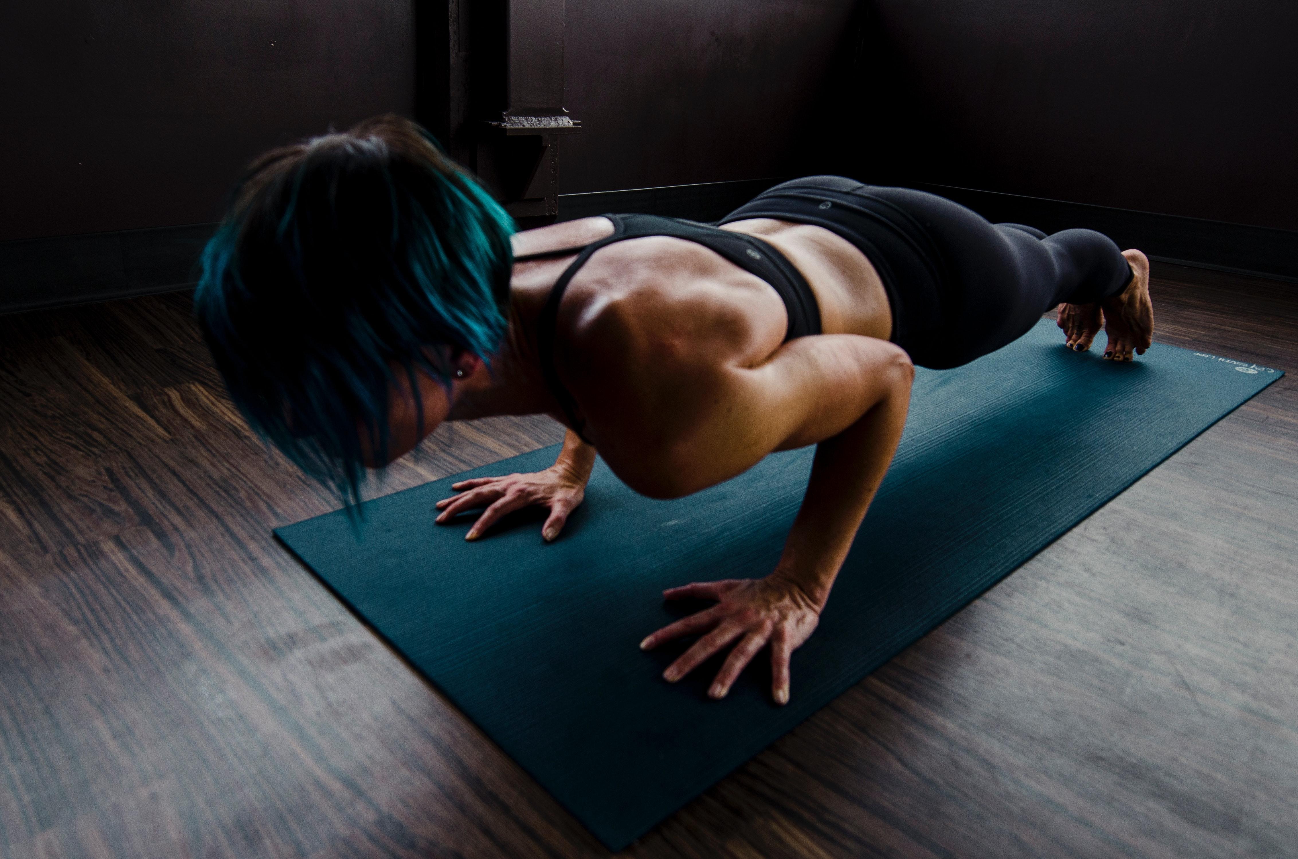 Woman doing push-ups.