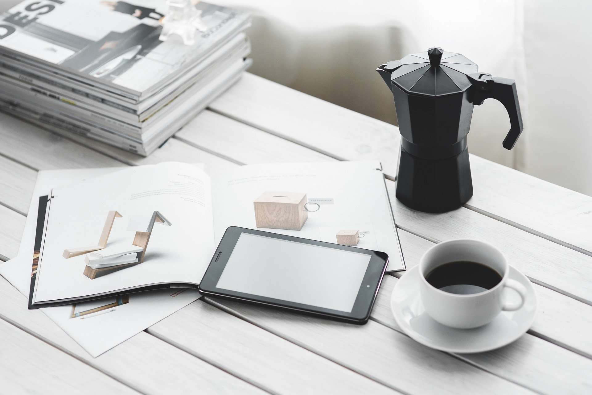 Cup of black coffee on a desk.