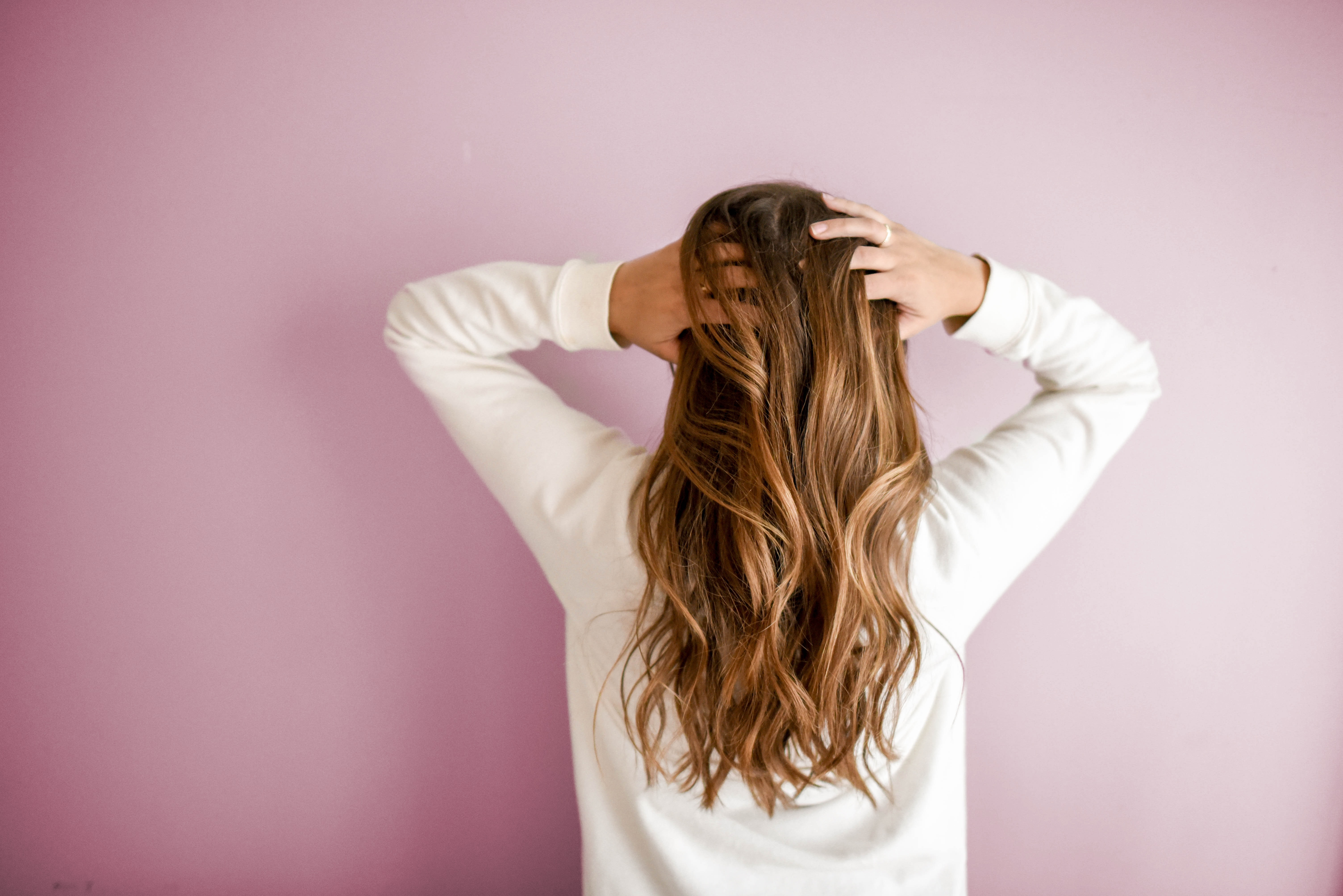 Woman from the back, showing her hair.